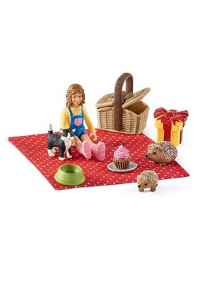 Dievčatko a zvieratká na pikniku