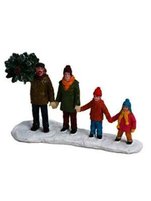 Rodina držiaca sa za ruky – nákup vianočného stromčeka